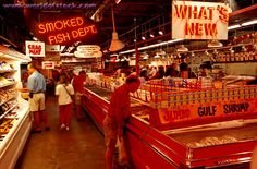 Pick up fresh fish at Wooly's Fish Market and enjoy the colorful crowds at the Strip District in Pittsburgh.
