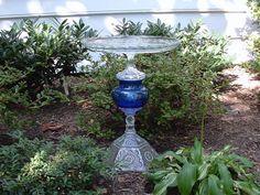 """Garden art.  Bird bath. Bird feeder.  """"The Marnie"""" is assembled art made with repurposed glass. Garden totem."""