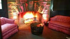 Fake fire in the fireplace at Happy Days Lodge was amazing! Lighting by something new entertainment. Lounge from borrow vintage rental.