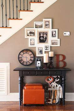 Turn a blank wall under the staircase into a gallery wall with black and white photos.