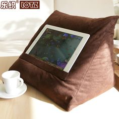 iPad pillow - image source via Google Search. (Cushion / rest / stand for Tablets / Kindles etc.) *** I bet you could easily DIY / sew one yourself :) ***