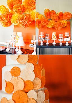 Orange party decorations, paper pom poms
