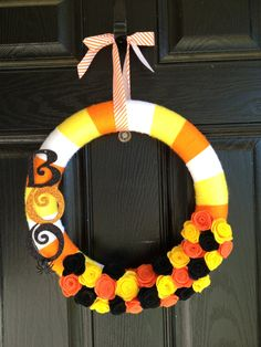 This handmade yarn and felt Halloween wreath will be the perfect accessory for your front door this holiday season. I have a lot of fun making