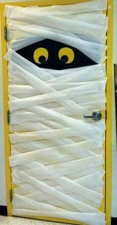 Preschool mummified door decoration.  See more preschool Halloween crafts and party ideas at one-stop-party-ideas.com