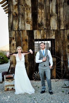 The Bonnie and Clyde of weddings- haha a true Texas wedding pose