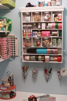 Excellent idea--hang an old spice rack up and fill it with ribbon instead of taking up counter or drawer space