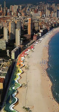 Colorful mosaic tile benches at the beach in Benidorm, Spain.