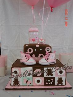 Girl baby shower cake.  Pink and brown.  Quilt pattern.