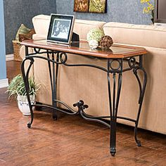 @Overstock - This metal sofa table provides a lovely style update for your living room. The black iron legs are offset by a dark cherry top for an elegant look. Display a vase collection or plants behind your sofa to create a warm and inviting decor.http://www.overstock.com/Home-Garden/Prentice-Sofa-Table/4117308/product.html?CID=214117 $118.79