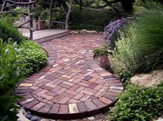 Low Maintenance Landscape, Natural Stone Patio, Lawrence, KS.... Love this brick patio! I love this shape and the greenery around it.
