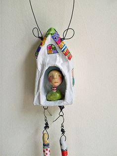 houselegs2 by LolliePatchouli, via Flickr. Little paper mache house. The legs are earrings. Love it!