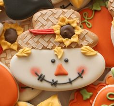 Scarecrow Face Cookies.  Step-by-step instructions on how to make these adorable little faces, using Christmas/Winter, Snowman   Cookie Cutters!  So cute!