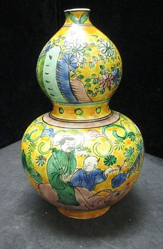 """CHINESE KANGXI MARKED PORCELAIN DOUBLE GOURD VASE Kangxi Dynasty mark on Bottom Floral Pattern with Man riding Ox and workers tending the field. Measures 7"""" Tall"""