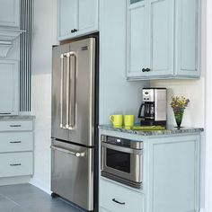 Custom cabinets enclose the microwave and fridge for a neat, flush look.   Photo: Julian Wass   thisoldhouse.com