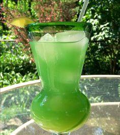 Lucky Leprechaun (1 fluid ounce Southern Comfort  1/2 fluid ounce Midori melon liqueur  1/2 fluid ounce Malibu rum  6 fluid ounces pineapple juice  1 dash blue curacao  lime wedge, for garnish)
