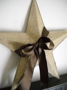 Burlap Star~mod podge a piece of burlap on a rusty thrift store star that I got for $1, trim it with twine and a glue gun, and wrap a brown satin ribbon around it, Crafty Cuteness!