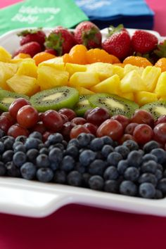Colorful Fruit Salad. Display nature's tasty rainbow for baby shower guests with berries, pineapples, kiwis and melons. Could buy the pre-made fruit trays