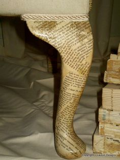 Decoupaged book pages on the legs of furniture.... Neat idea! Would be great in a little reading nook.