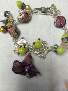 Polymer flower bracelet,   with agate and glass spectra beads, silverware and brass components nickle free