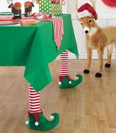 Elf table leg covers - Sold Out but they'd be so easy to make. Use Christmas socks or tights and cut out felt elf shaped shoes, glue together and stuff with batting.