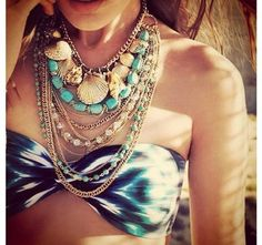 bandeau top with necklaces