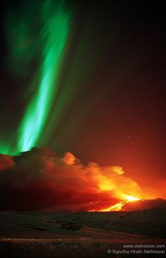 The Northern Lights over a volcanic eruption in Mount Hekla in 1991, with the trail of a plane also visible
