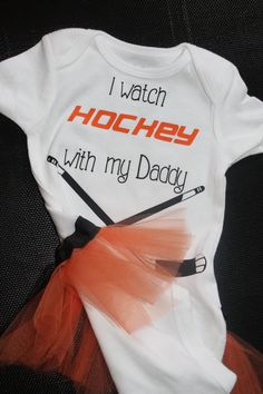 "Cute! I was SO going to add a tutu to the hockey jersey I got if the baby was a girl! lol  Girls ""I watch hockey with my daddy"" tutu onesie. $18.00, via Etsy."