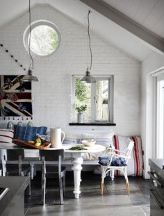 Union Jack flag wall art, high ceilings, porthole window and that elegant bentwood, dipped chair.