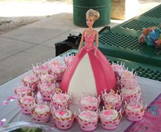 Princess Barbie & cupcakes - Barbie -  plastic bodice and matched the color of the skirt - Wilton wonder mold w/RBC... strips to give the look of layered fabric. Cupcakes - sprinkles and princess cake picks. don't need to do much when you use the wrappers. via Cake Central
