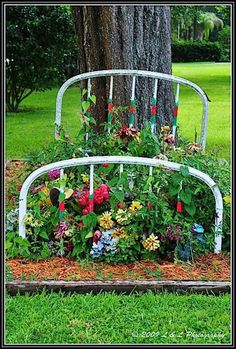 Flower Bed <3. Very cute way to use an old rustic bed frame!