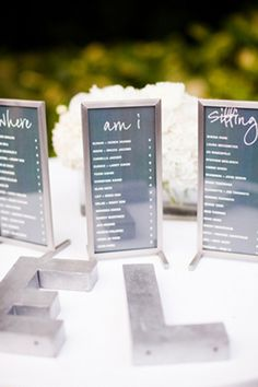 """Creative seating chart idea: display three stand-up signs with guests' names and their table numbers. Include read-across sayings like """"Where Am I Seated?"""" or """"Where's My Table?"""""""