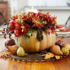Turn a pumpkin into a vase with this pretty pumpkin centerpiece!