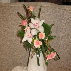 Step by step directions for making an angled bridal bouquet.  Learn what products you need and how to buy those professional florist supplies