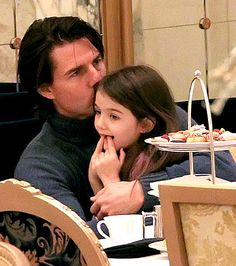 Tom Cruise and Suri having tea