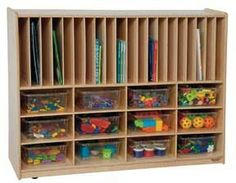 """Wood Designs - Tip-Me-Not™ Portfolio Storage with Twelve Clear Trays GREENGUARD® Children & Schools certified. Tip-Me-Not™ design provides additional classroom safety. Versatile divided storage areas for puzzles, games, and books, plus a generous storage area includes twelve clear rectangular tote trays. All surfaces and back are 100% Healthy Kids™ Plywood with our exclusive Tuff-Gloss™ UV finish. Fully assembled on casters. Lifetime warranty. 36""""H x 48""""W x 16""""D."""