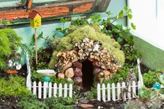Fairy Garden Tutorial - DON'T MISS THIS ONE - everything from preparing a box (great tips) to making the house to some CUTE details - I have to have the beehive, gazing ball, and swing! From WhatWillWeDoToday - #fairy #garden #tutorial #gardening #DIY #crafts #nature #miniature - tå√