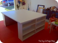 huge work table made from 2 hollow doors, ($25) and 4 bookshelves($16 ea) and large L brackets