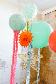 assortment of sparkles, balloons, and paper lanterns for some whimsy // photo by MattandJulieWeddings.com // styling by CoutureEventsByLottie.com