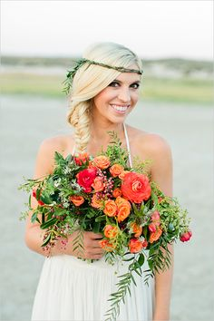 Orange and red bouquet recipe perfect for the boho bride! Captured by Callie Hobbs Photography #weddingchicks http://www.weddingchicks.com/2014/08/19/sunset-beach-hair-and-bouquet/