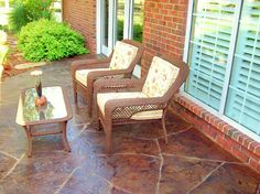 Gorgeous textured patio made with textured concrete, DCI English Red and Cola Acid Stains acid stain