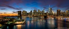 Panoramic View of the Brooklyn Bridge and Lower Manhattan at Dusk by Photographer Andrew Prokos