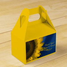 Customize the pretty #Sunflower on Blue #Wedding #Favor #Box with the personal names of the bride and groom and marriage ceremony date. These elegant custom botanical favor boxes feature a floral photograph of a yellow sunflower blossom with a blue background. Perfect for a classy yellow sunflower party, shower or wedding theme. #sunflowerwedding #favorbox #favors