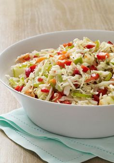 """Sweet & Sour Slaw -- Meet the new """"it girl"""" of the coleslaw worLd. One bit sweet, another bit sour--she's a healthy living recipe, well-dressed and looking to pair up with a dependable burger."""