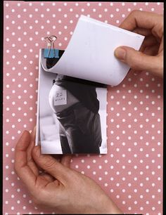 Love this idea and can't wait to do it...Clip all pregnancy pics together to create a flip book and watch that belly grow..:)