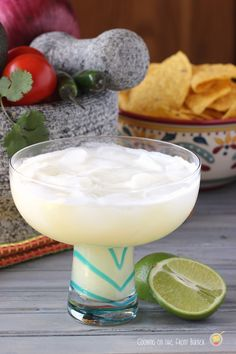 Colada Margarita (6 oz white tequila 2 oz sour mix 4 oz pineapple juice 2 oz fresh lime juice 2 oz cream of coconu)