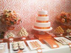 Orange and white dessert table