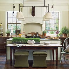 80 Tasty Kitchens | To balance out the traditional feel of the rest of the home, the kitchen's countertops, appliances, and cabinets are all clean and contemporary. | SouthernLiving.com
