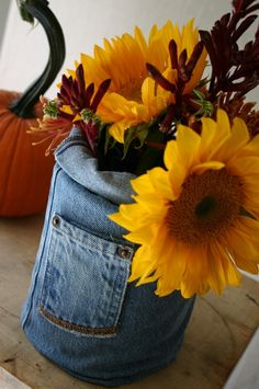 Casa Montada: Floral arrangement in a can covered by denim