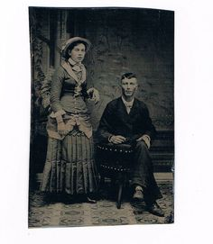Tintype of 1880s Couple Lady with Hat and Lots of Trim Bustle Era