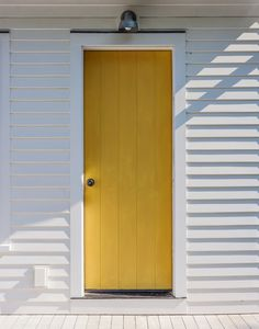 Several of the doors surrounding the gardens are painted a sunny yellow: Benjamin Moore Luminous Days from its MoorGlo soft gloss acrylic line. post: Sheila Bonnell Orleans Cape Cod Kitchen Garden. via Gardenista